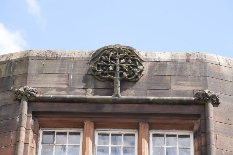 Exterior. Detail of tree motif.