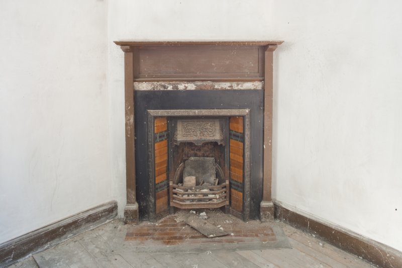 Interior. Detail of fireplace, upper floor north rear room.