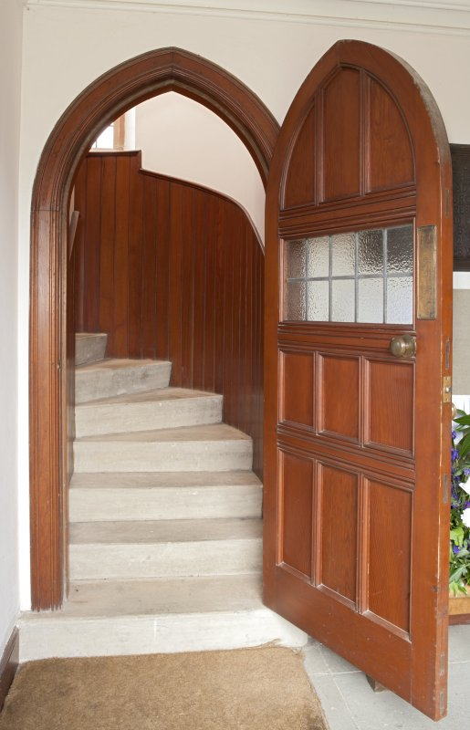 Detail of door to loft and curved stair.