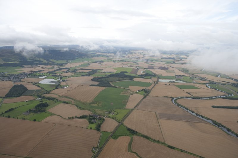 General oblique aerial view along Strathearn with Dunning to the left, looking WSW.
