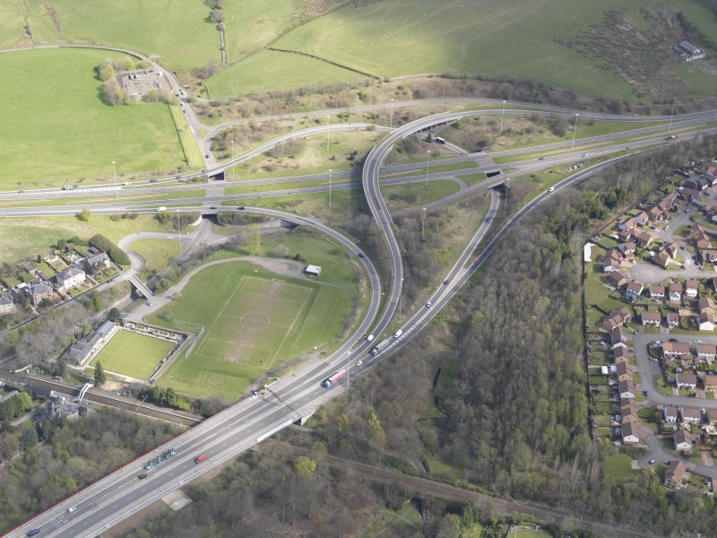 Oblique aerial view of the junction of the A898 and the Great Western Road, looking NE.