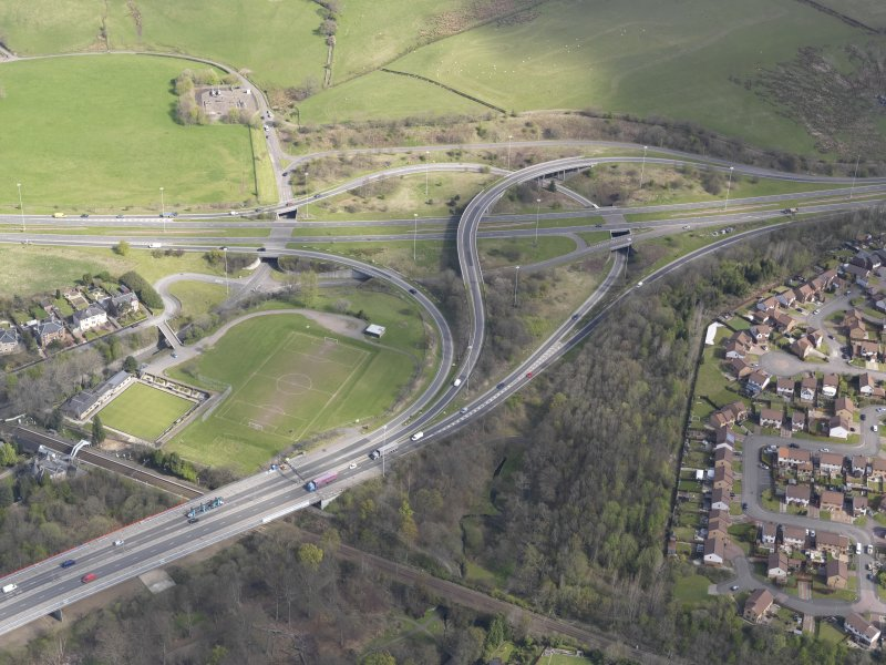 Oblique aerial view of the junction of the A898 and the Great Western Road, looking NNE.