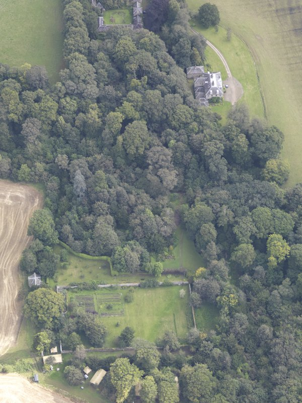 Oblique aerial view of Chesters House, taken from the WSW.