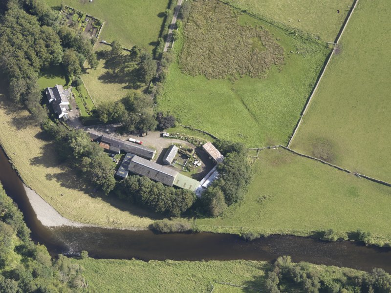 Oblique aerial view of Drumelzier Castle, taken from the WNW.