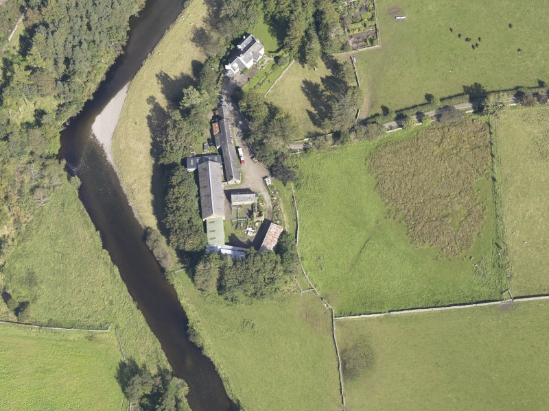 Oblique aerial view of Drumelzier Castle, taken from the SW.