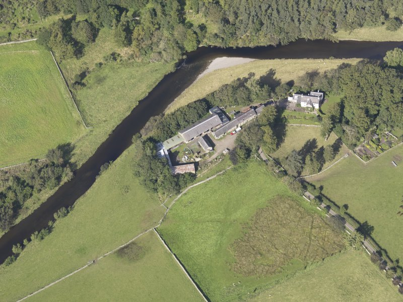 Oblique aerial view of Drumelzier Castle, taken from the S.