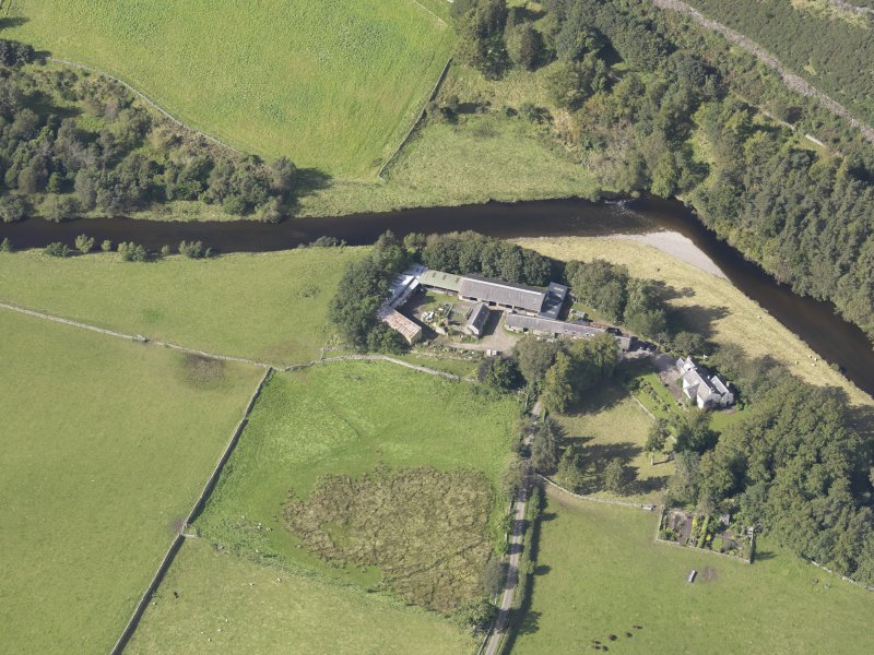 Oblique aerial view of Drumelzier Castle, taken from the SE.