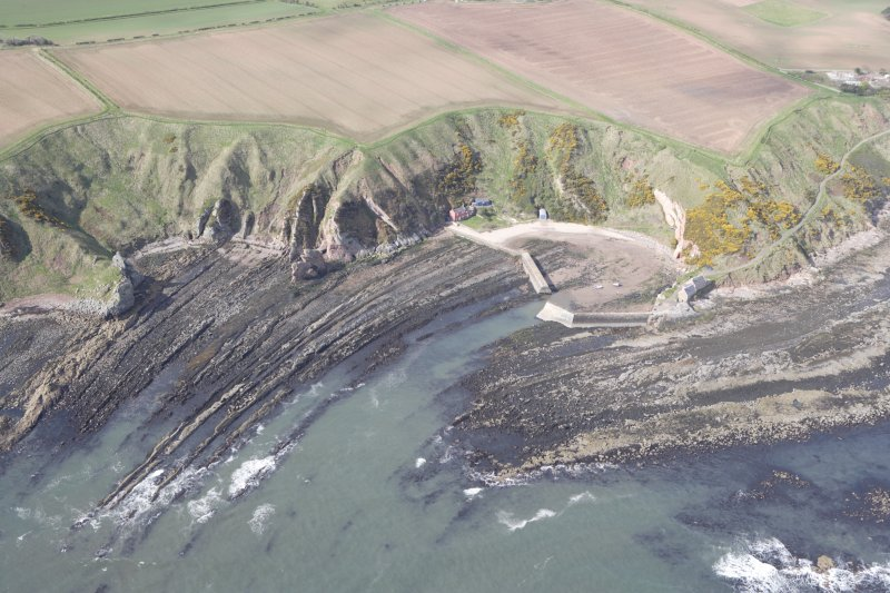 Oblique aerial view of Cove Harbour, Heathery Heugh looking SW.