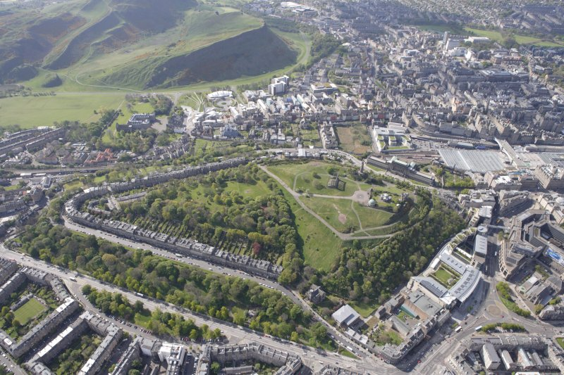 General oblique aerial view of Holyrood Park, Arthurs Seat, Calton Hill, Canongate and Royal Terrace Gardens, looking S.
