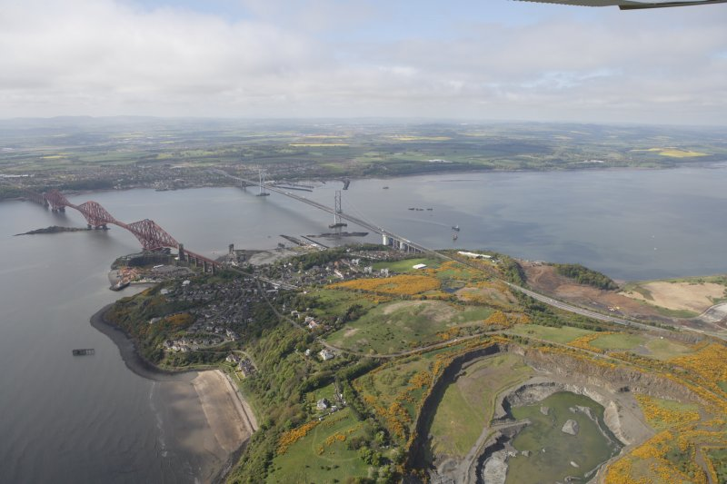 General oblique aerial view of Forth Rail Bridge, Forth Road Bridge, North Queensferry, Cruicks Quarry and construction of Queensferry Crossing, looking SW.