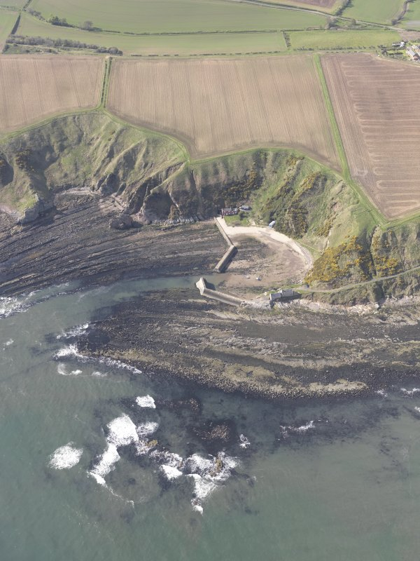 Oblique aerial view of Cove Harbour, Heathery Heugh, looking SW.