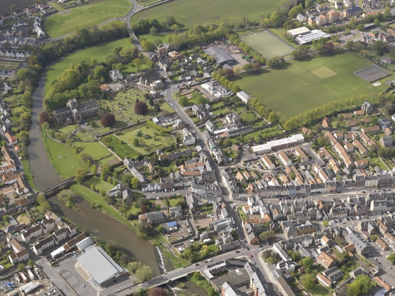 oblique aerial view of St Marys Parish Church, Nungate Bridge, Victoria Bridge, Haddington, looking SSW.