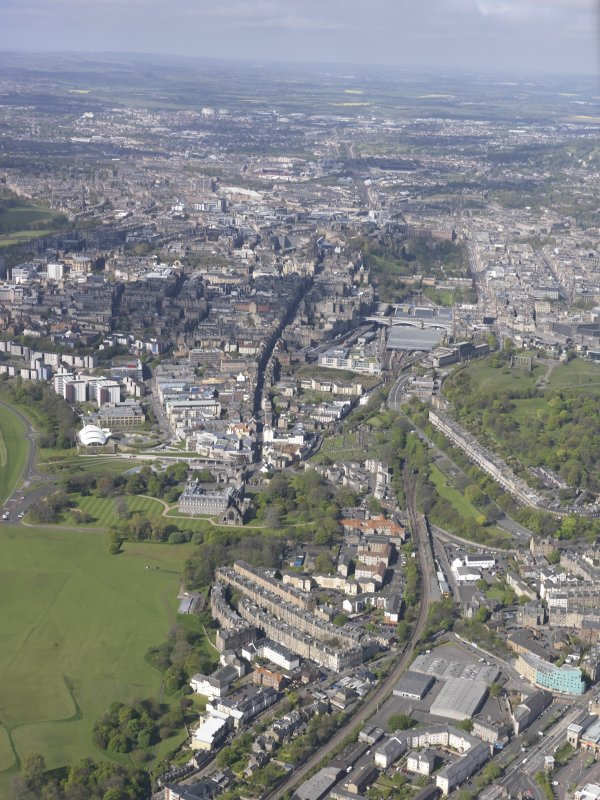 General oblique aerial view of Holyrood Park, Calton Hill, Royal Mile, Old Town and New Town, looking W.