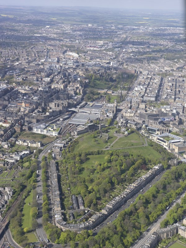 General oblique aerial view of Calton Hill, Royal Mile, Old Town and New Town, Waverley Railway Station, looking SW.