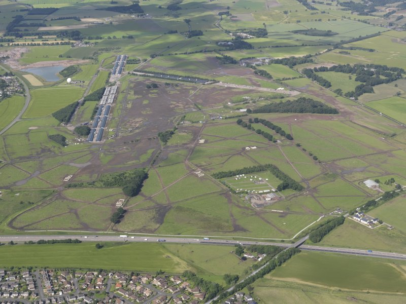 General oblique aerial view of the T in the Park site at Balado Bridge Airfield, looking W.