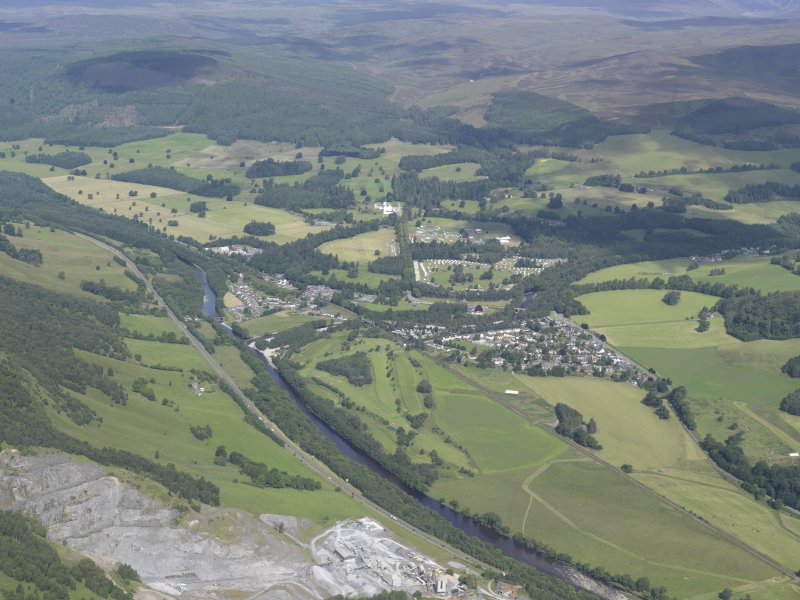 General oblique aerial view of Blair Atholl with Blair Castle beyond, looking NW.