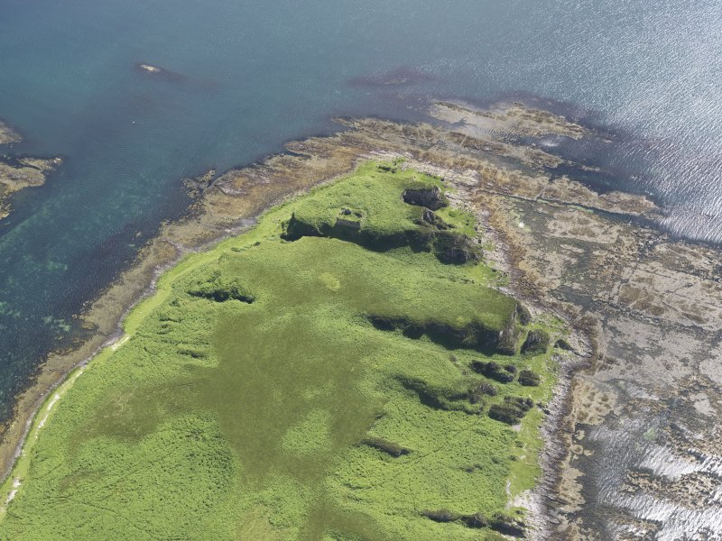Oblique aerial view of Am Fraoch Eilean and Claig Castle, looking W.