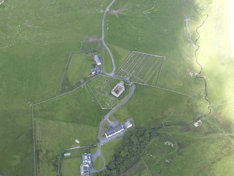 Oblique aerial view of Kilchoman House and Kilchoman Old Parish Church, looking NW.