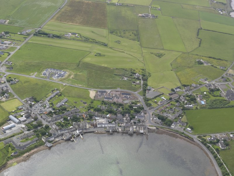 General oblique aerial view of St Margarets Hope and South Ronaldsay Golf Course, looking SW.