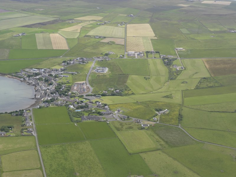 General oblique aerial view of St Margarets Hope and South Ronaldsay Golf Course, looking SE.