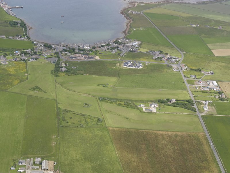 General oblique aerial view of St Margarets Hope and South Ronaldsay Golf Course, looking NNE.