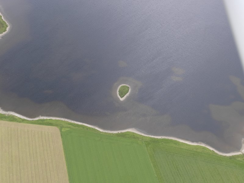 Oblique aerial view of Holm of Groundwater and Loch of Kirbister, looking SW.