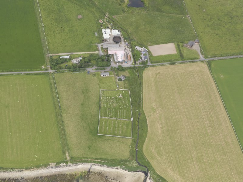 Oblique aerial view of St Nicholas's church, Bu of Orphir, looking NNW.
