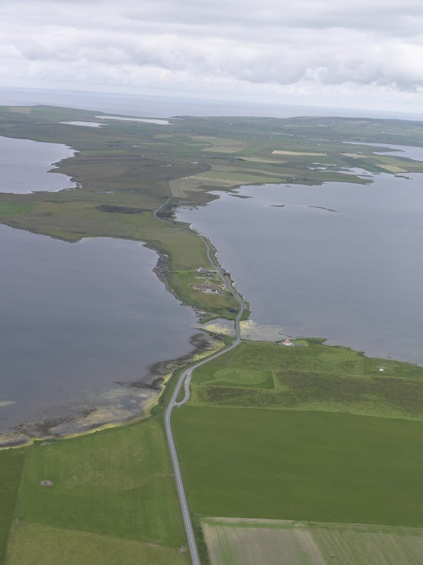 General oblique aerial view of Ring of Stenness, Ring of Brodgar and Bridge of Brodgar, looking NW.