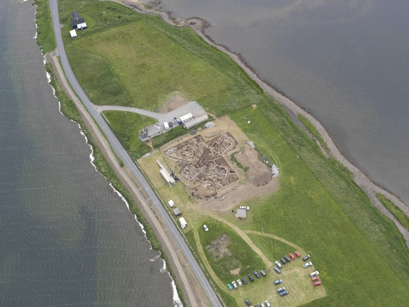 Oblique aerial view of the excavations at Ness of Brodgar, looking NNW.
