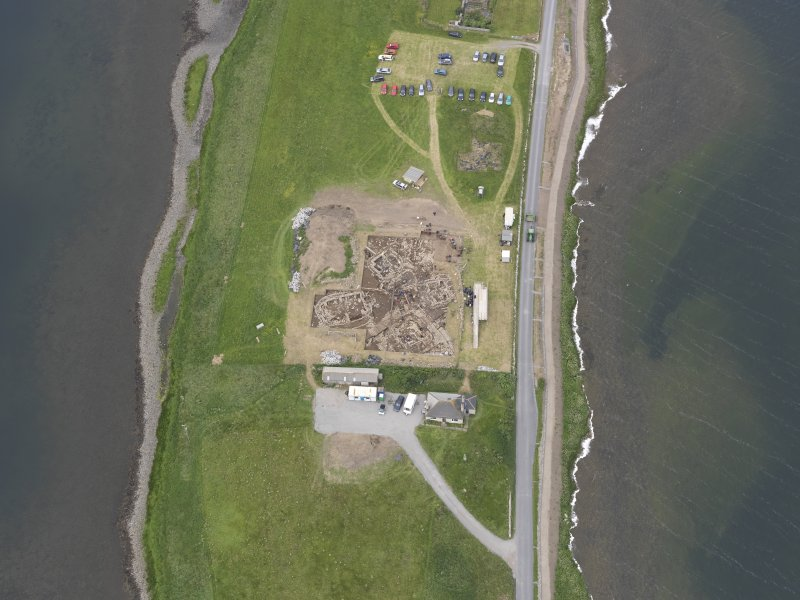 Oblique aerial view of the excavations at Ness of Brodgar, looking NW.