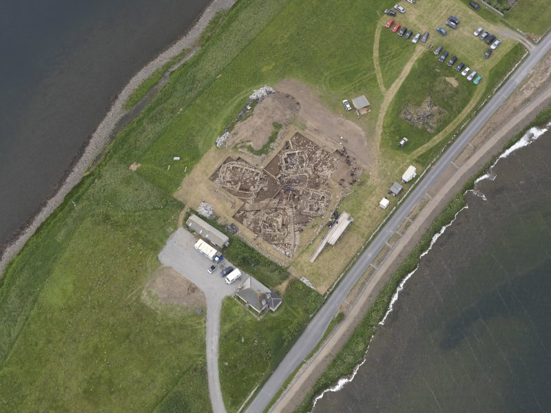 Oblique aerial view of the excavations at Ness of Brodgar, looking W.