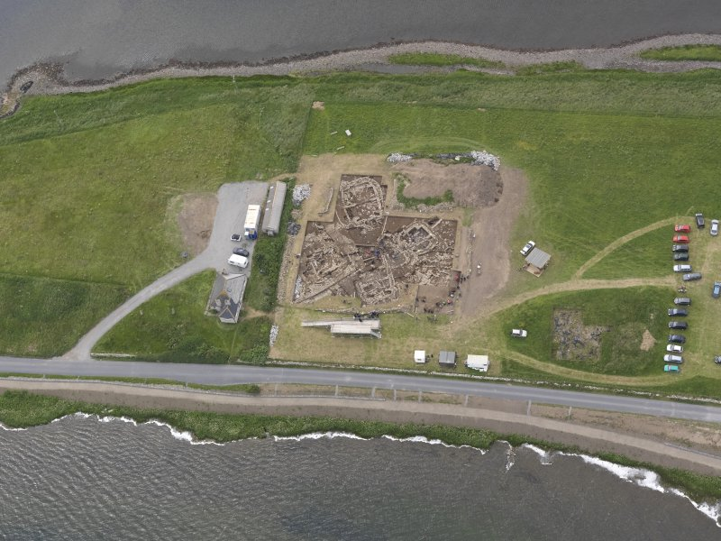 Oblique aerial view of the excavations at Ness of Brodgar, looking SW.
