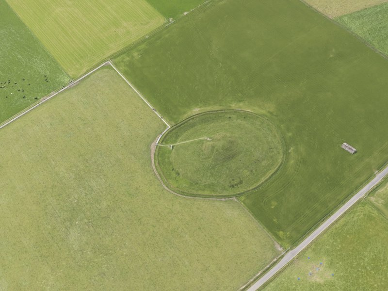 Oblique aerial view of Maeshowe Chambered Cairn, looking SW.