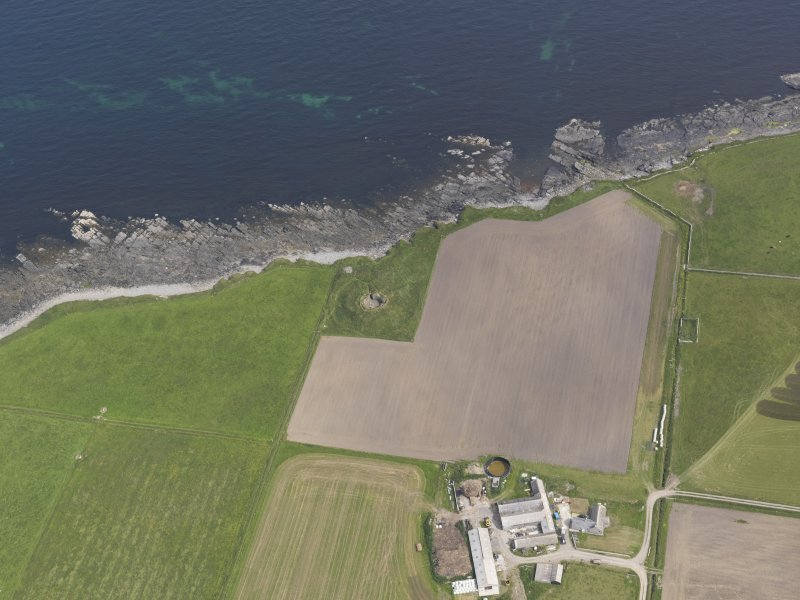 Oblique aerial view centred on the Hillock of Burroughston broch, looking E.