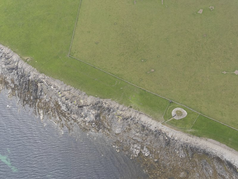 Oblique aerial view centred on Quoyness chambered cairn, looking SW.