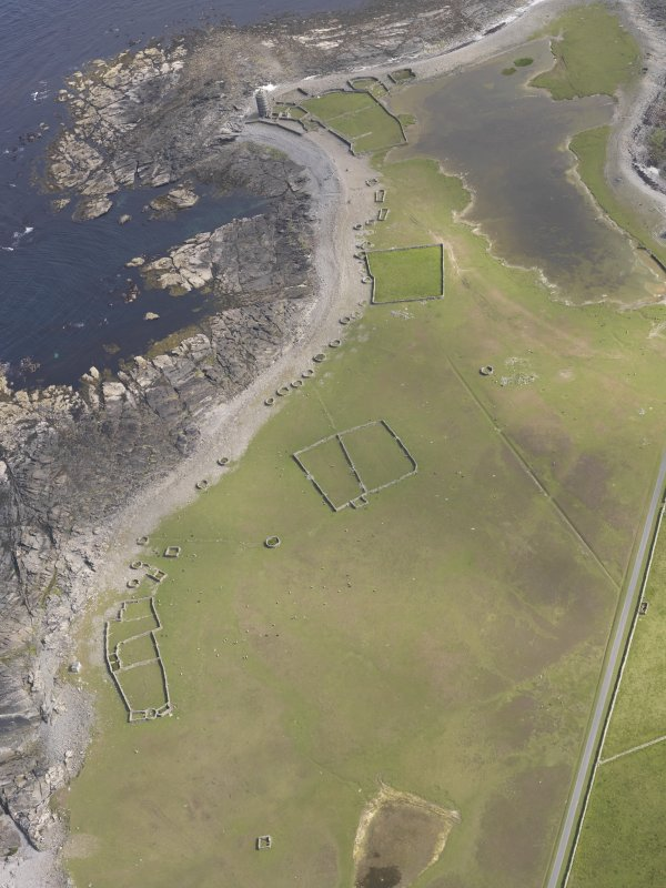 Oblique aerial view centred on the enclosures and planticrues, and the Old Beacon, looking S.