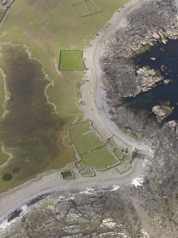 Oblique aerial view centred on the enclosures and planticrues, and the Old Beacon, looking N.