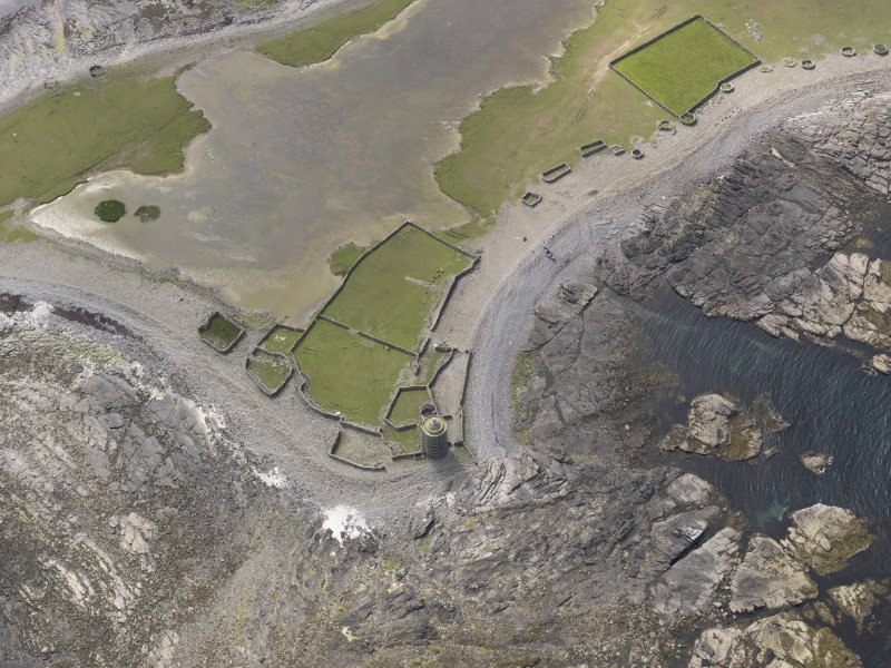 Oblique aerial view centred on the enclosures and planticrues, and the Old Beacon, looking W.