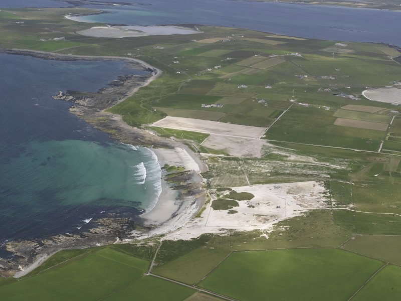 General oblique aerial view of Westray, centred on the Links of Noltland, looking NE.
