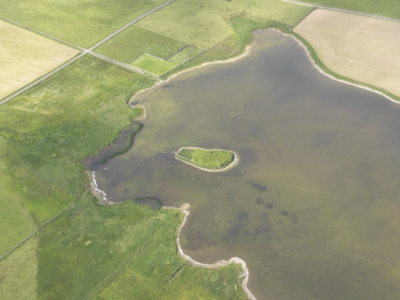 Oblique aerial view of the Loch of Wasbister, centred on the Burrian, looking N.