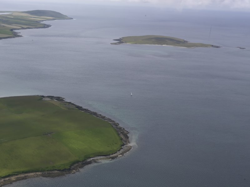 General oblique view over Aiker Ness to Eynhallow, looking NW.