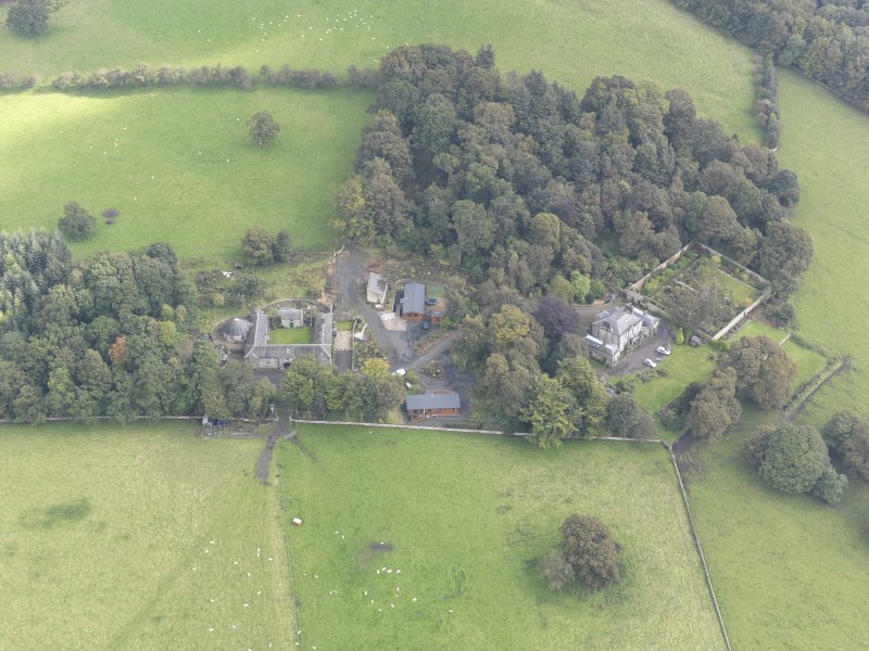 General oblique aerial view of Benarty House with adjacent walled garden and steading, looking to the NE.