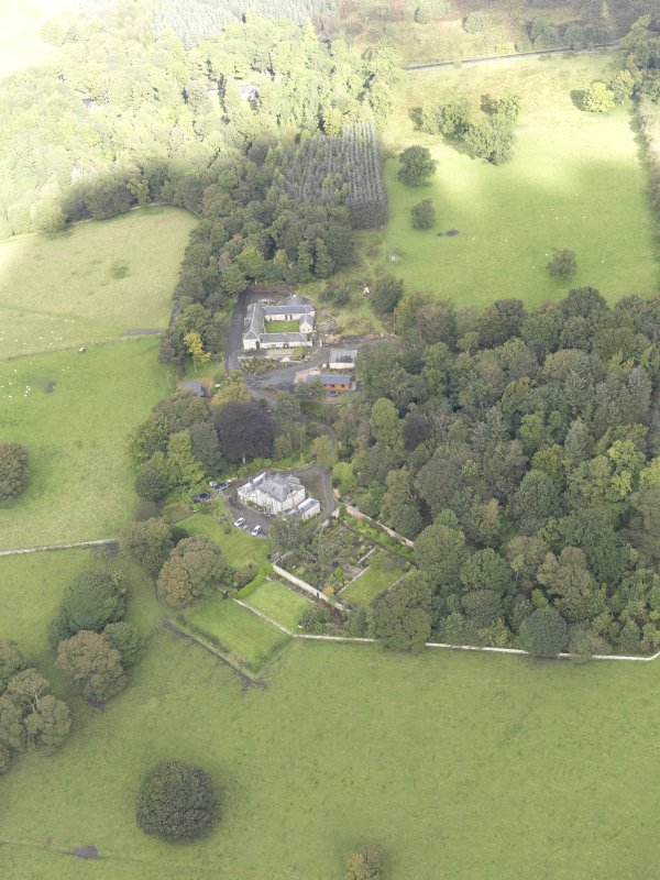 General oblique aerial view of Benarty House with adjacent walled garden and steading, looking to the NNW.