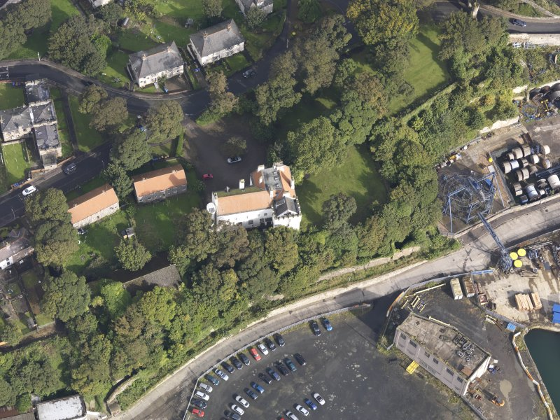 Oblique aerial view of Rossend Castle, looking to the N.