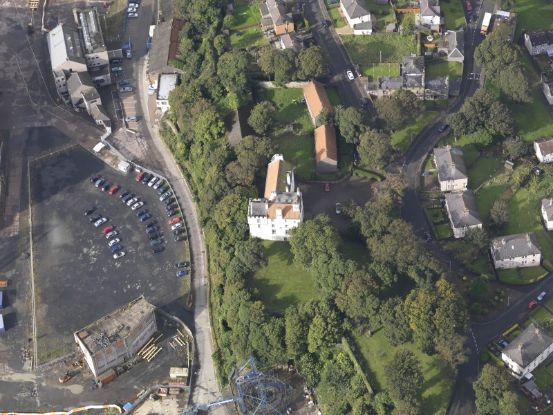 Oblique aerial view of Rossend Castle, looking to the W.