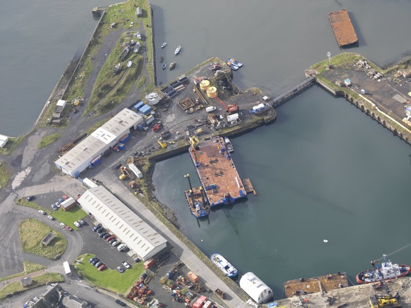 Oblique aerial view of Burntisland West Dock, looking to the SW.