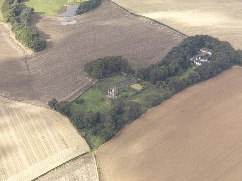 Oblique aerial view of Piteadie Castle, looking to the WSW.