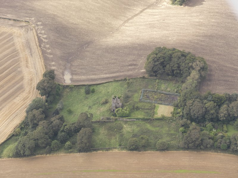 Oblique aerial view of Piteadie Castle, looking to the SW.