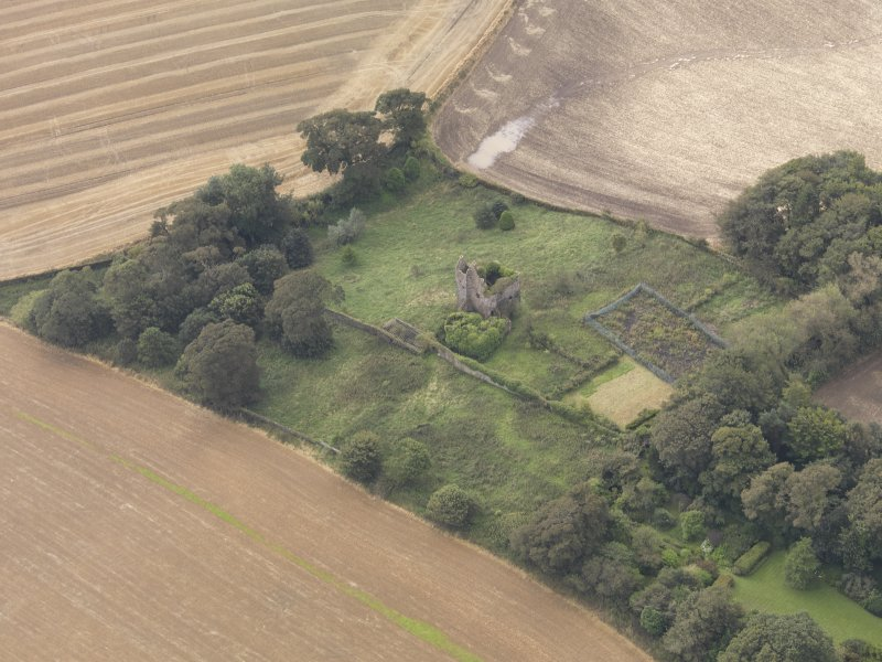Oblique aerial view of Piteadie Castle, looking to the S.
