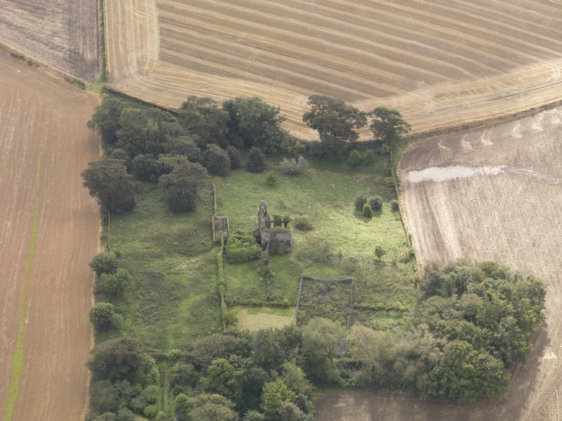 Oblique aerial view of Piteadie Castle, looking to the SSE.